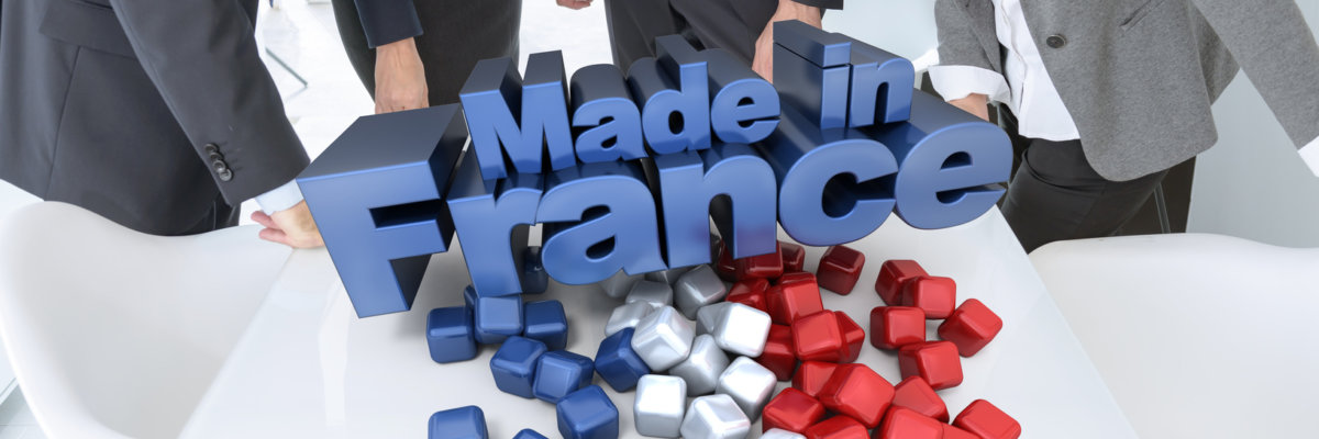 Business people around a table with a made in France 3D sign